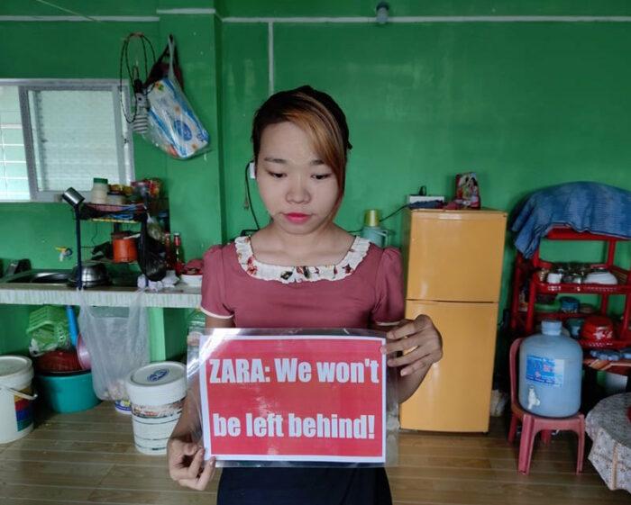 Eine Näherin in Myanmar protestiert gegen das Modeunternehmen Zara
